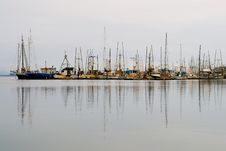 Old Fishing Boats Lined-up In The Harbor Stock Photos
