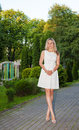 Free Young Woman In White Dress Posing Standing In A Park Royalty Free Stock Image - 42684926
