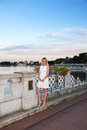 Free Young Woman In A White Dress Near The Lake At Sunset Stock Image - 42684931