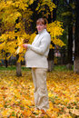 Free Pregnant Woman In Autumn Park Hold Maple Leaf Stock Image - 4273451
