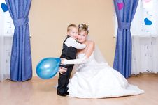 The Bride Embraces Her Little Brother Royalty Free Stock Photos