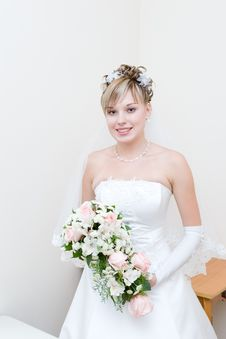 A Beautiful Bride With A Flower Bouquet Stock Photo