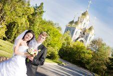 A Bride And A Groom Near The Church Stock Photo