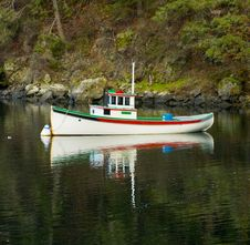 Boat In Calm Bay Waters Stock Images