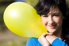 Free Cute Girl With Yellow Colored Balloon Royalty Free Stock Photos - 4276038
