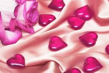 Free Pink Rose On Satin With Hearts Royalty Free Stock Photo - 4277565