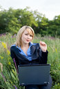 Free Contented Businesswoman Sitting On Grass Royalty Free Stock Photo - 4282725