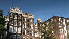 Free Amsterdam Buildings Reflected On A Canal. Royalty Free Stock Photography - 4280687