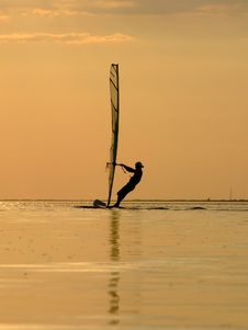 Silhouette Of A Wind-surfer On A Sunset 1 Royalty Free Stock Photo