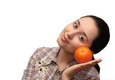 Free Girl With An Orange Stock Photo - 4286340