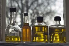 Free Four Bottle Of Olive Oil Royalty Free Stock Images - 4286409
