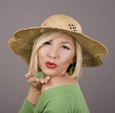 Free Blonde Straw Hat Blowing Kiss Royalty Free Stock Photo - 4287435