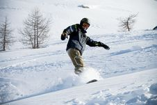 The Snowboarder Riding On A Virgin Soil Stock Photo