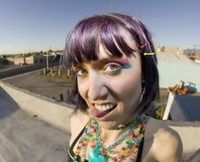 Free Cute Young Woman On A Roof Sticking Out Her Tongue Royalty Free Stock Photography - 4293057