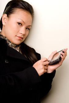 Free Female Entering Data Into PDA - Technology Series Stock Photos - 4294273