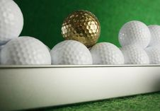 Free Golfball In Gold Stock Image - 4296091