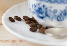 Free Some Coffee Beans On Saucer With Cup Of Coffee Stock Photography - 4298472
