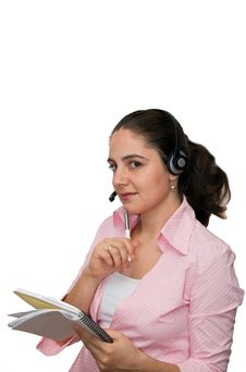 Pretty Girl Listening And Writing Stock Image