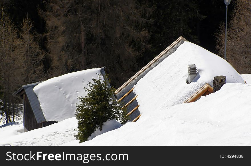 Snow-covered alpine huts