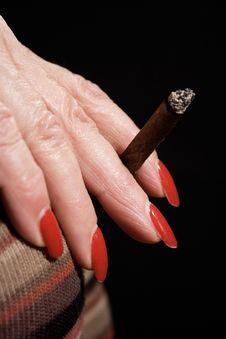 Smoking A Small Cigar Royalty Free Stock Photos