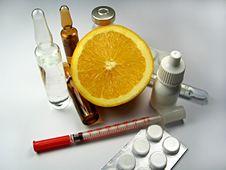 Orange Fruit Surrounded By Drugs, Pharmacy Pills Stock Photo