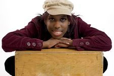 Free Young Black Woman Leaning On A Box With Room For Copy Space Royalty Free Stock Photography - 436757