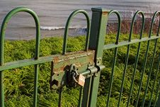 Free Padlock On Gate Overlooking Sea Royalty Free Stock Photography - 439737