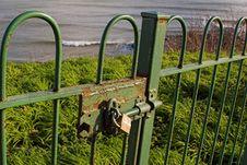 Padlock On Gate Overlooking Sea Royalty Free Stock Photography