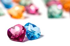 Magenta, Blue And A Group Of Colored Glass Hearts Royalty Free Stock Photos