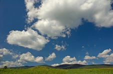 Free Big Clouds On Blue Sky Over Green Hill Royalty Free Stock Photos - 4310428