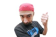 Caucasian Young Man Gesturing With Thumb Stock Photo