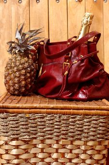 Free Pineapple A Champagne And A Bag Stock Photography - 4311552