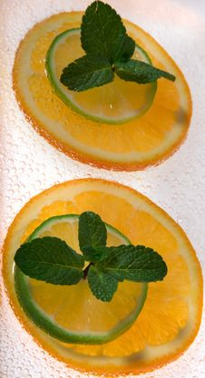 Lime And Orange Segments Whith Mint Royalty Free Stock Images