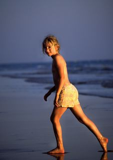 Free Young Girl Strolling Along The Beach Royalty Free Stock Photography - 4312207