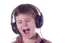 Free The Little Boy Emotionally Listens To Music Royalty Free Stock Images - 4318569