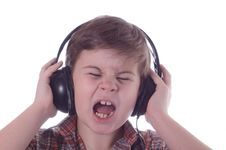 Free The Little Boy Listens To Music Stock Image - 4318681