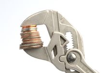 Pliers With Some Coins Royalty Free Stock Photo