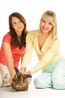 Two Girls Playing With Bunny Royalty Free Stock Images