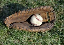 Free Baseball Glove And Ball In The Grass Stock Images - 4325374