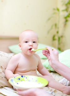 Free Mother Feed Baby By Porridge Stock Image - 4328761