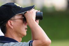 Free Chinese Man Looking Through Binoculars Stock Images - 4332454