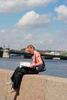 Girl Reading Magazine On Canal Border Royalty Free Stock Image