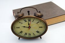 Free Old Hours And Book Stock Image - 4335091