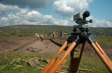 Working On Archeological Site With Theodolite Royalty Free Stock Photo