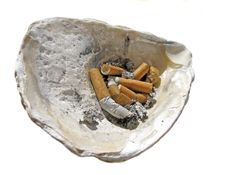 Cigarette Butt In The Shell Ashtray Stock Images