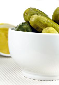 Pickled Cucumbers In A White Dish Stock Image