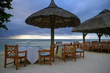 Free Tropical Restaurant Tables On Beach At Sunset Royalty Free Stock Photography - 4337727