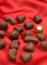 Free Valentines Chocolates On Red Silk Stock Image - 4345981