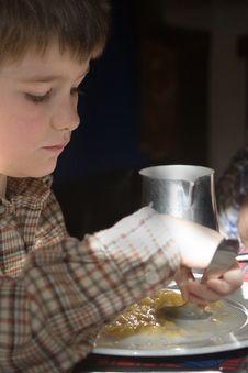Child Who Eats Italian Polenta Stock Photography