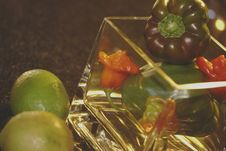 Green Peppers, 3 Peppadew And Lemon Stock Image